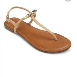 Tan sandals with gold bow